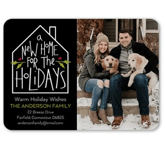 A custom holiday moving announcement card with a collage of family pictures
