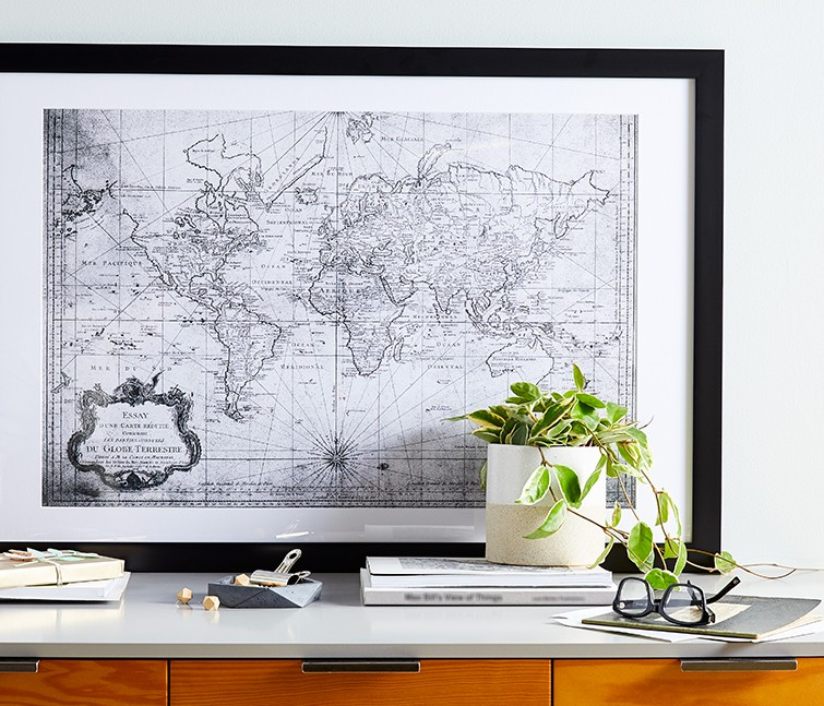 Large format custom framed map photo print on table as wall art