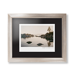 Modern gallery framed print with metallic frame and photo of lake