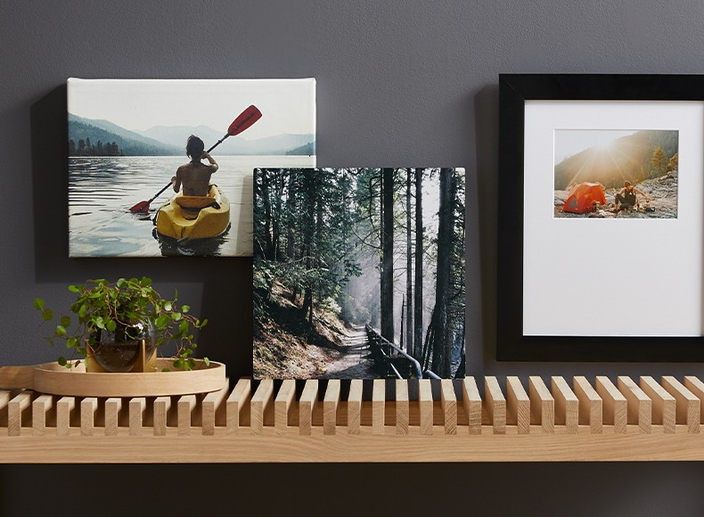 Photo prints in framed photo style, square photo style, and canvas print on shelf