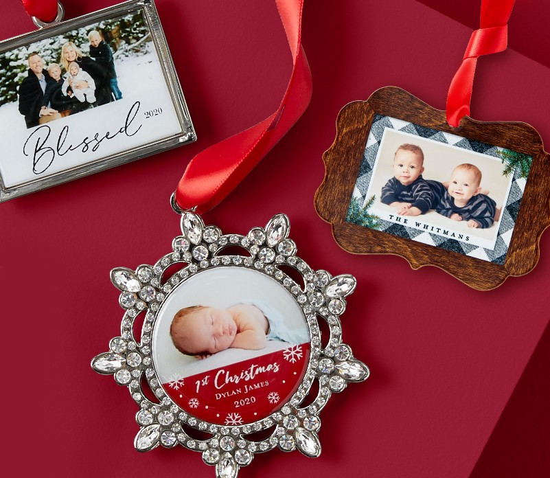 Three personalized Christmas ornaments with photos of babies and a family