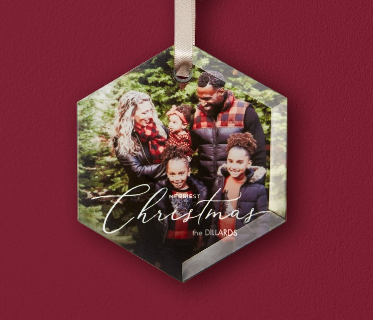 A personalized glass ornament that says Merry Christmas with a photo of a family
