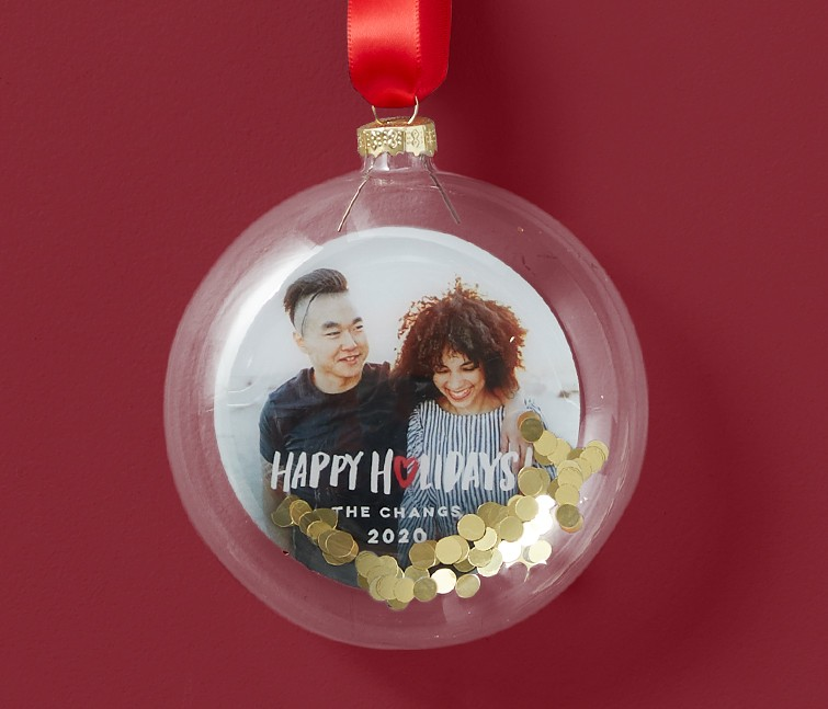 A personalized glitter Christmas ornaments that says Happy Holidays with gold glitter and a picture of a couple