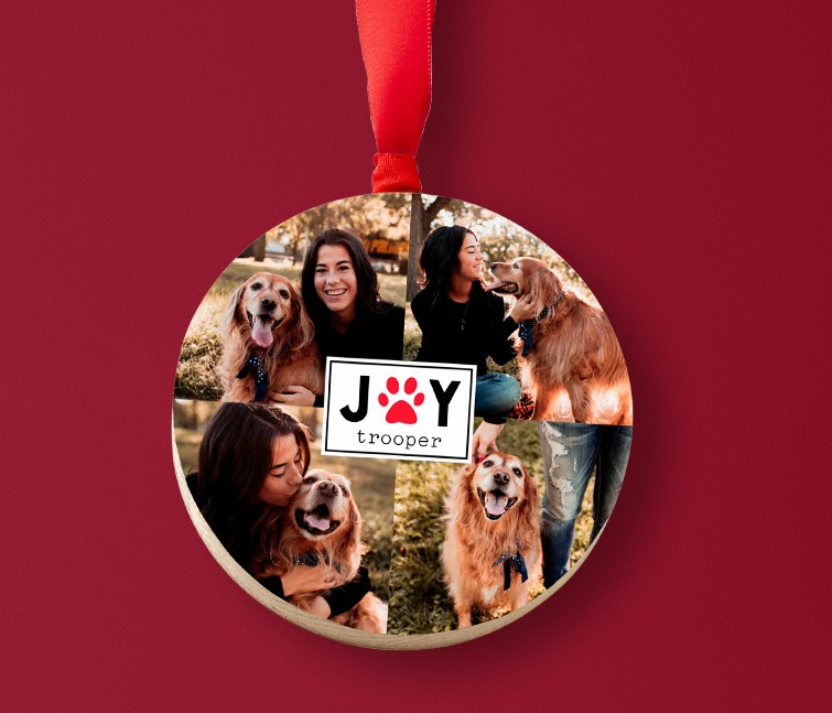A personalized wooden Christmas ornament that says Joy with a collage of photos of a woman and her dog