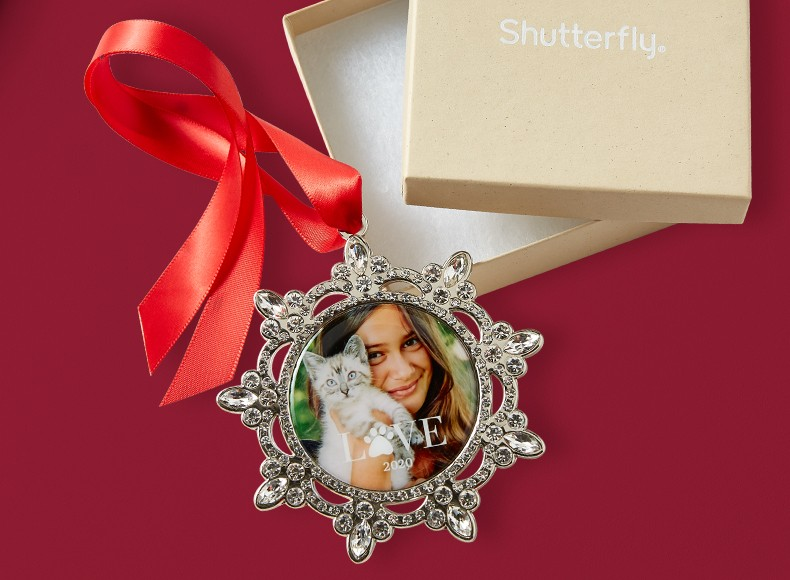 A custom photo Christmas ornament in a Shutterfly gift box