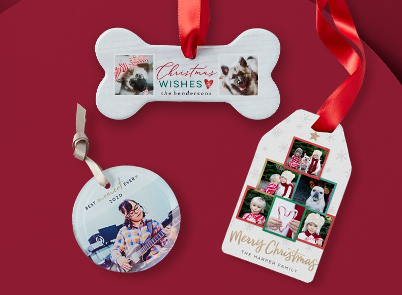 A dog bone ornament, a circle ornament, and a rectangle ornament with photos on each.