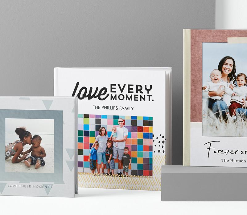 Three custom photo books that are differnet sizes