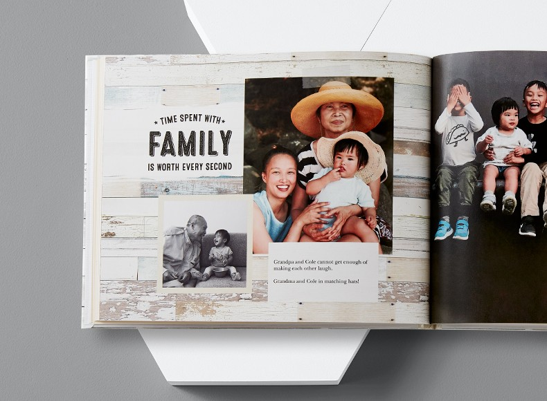 A family photo boook with a collage of family pictures and custom text on the pages