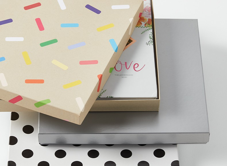 A custom photo book made with a gift box