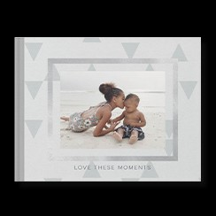 Simply Gray custom photo book style with a picture of two kids at the beach on the cover