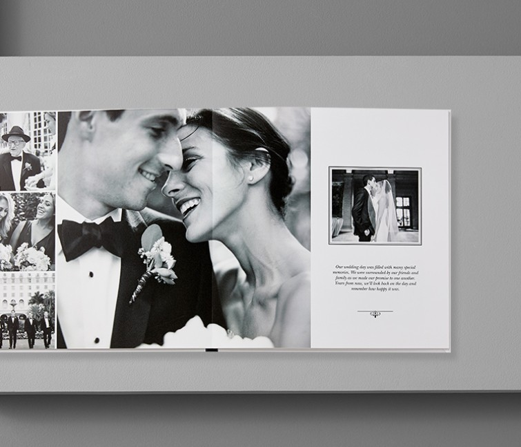 A custom leather wedding photo book with pictures of a bride and groom