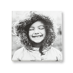 A black and white custom canvas print with a picture of a child smiling