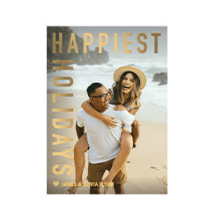 A personalized holiday card that says Happiest Holidays with a picture of a couple on the beach