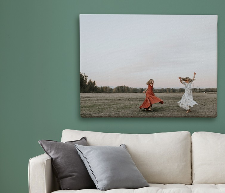 Large format canvas print with picture of family hanging in living room