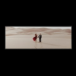 Single piece wall art with panoramic photo of engagement in desert