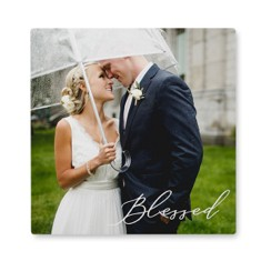 Photo tiles of the happy couple make meaningful wall art bridal shower gifts.