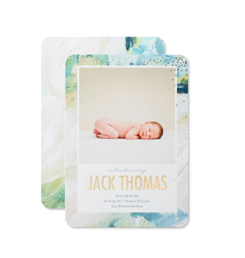 Custom birth announcement card with a picture of a newborn sleeping baby