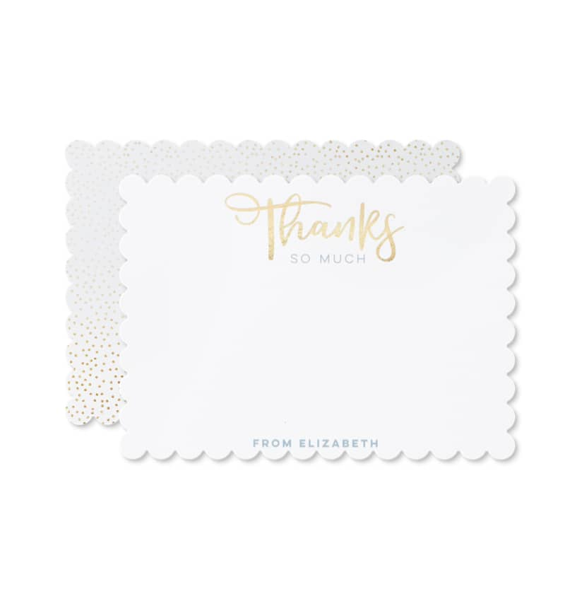 A white personalized thank you card that says thanks on the top